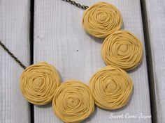 Bib Necklace Yellow Rosette Necklace Statement Necklace Fabric Rosette Jewelry Fabric Bib Necklace Unique Necklace Handmade Necklace by SweetCamiJayne on Etsy https://www.etsy.com/listing/207392644/bib-necklace-yellow-rosette-necklace