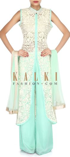 Buy Online from the link below. We ship worldwide (Free Shipping over US$100). Product SKU - 304252. Product Link - http://www.kalkifashion.com/green-suit-adorn-in-resham-and-sequin-embroidery-only-on-kalki.html