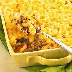 This version of the classic Greek casserole recipe is made with elbow macaroni, ground beef, and an egg- enriched white sauce. To simplify it, bottled Alfredo sauce replaces the homemade white sauce.