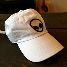 NWOT Brandy Melville hat. Brandy Melville. Authentic. Alien baseball hat. White. Adjustable. NWOT! SOLD OUT! Brandy Melville Accessories Hats