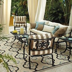 I like the color and pattern of this rug for the living room. Also an indoor/outdoor rug would hold up well with pets.