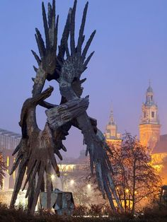 Royal Wawel Cathedral, Krakow, Poland - Kraków's Royal Wawel Castle and Cathedral is illuminated behind a World War II memorial by sculptor Bronisław Chromy. Perched on Wawel Hill, the 14th-century cathedral houses 18 chapels, as well as tombs, artifacts, and a library. (National Geographic)