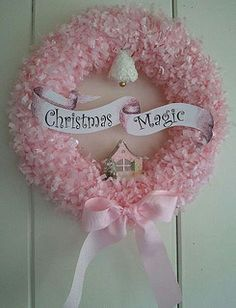 'This beautiful wreath is hand-made by me featuring pink tissue garland, a antique frosted foam bell with gold embellishment, a mini paper house with green bottle brush tree and made complete with a large pink grosgrain ribbon tied in a bow. Mini house designed by Mary Holcomb. Size 12 inches circle.'