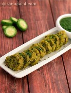 Karela and flour dumplings that are enlivened with the addition of onions and garlic to make a delicious breakfast. This recipe makes use of karelas and garlic, the two ingredients that are said to be diabetic friendly as they help to maintain the blood sugar levels.   Serve them hot, along with Low Calorie Green Chutney.