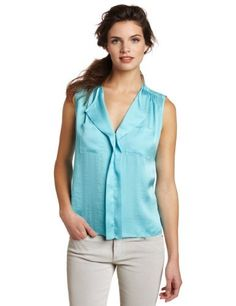 Vince Camuto Women's Sleeveless Soft Ruffle Front Shirt Vince Camuto. $74.00. Made in China. Machine Wash. Sleeveless ruffle front. Front pockets. polyester