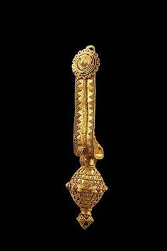 Description: Temple Ornament with Spherical Pendant Material(s): Gold Date of Object: 330 BC Origin: Colchian
