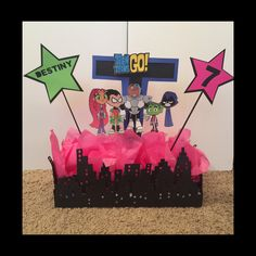 Teen Titans Go party idea, center piece, foam base, Cricut city boarder, skewers, and tissue.