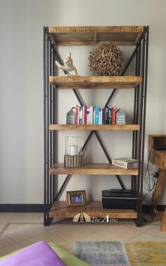 Prefer a chunky industrial look? This one combines mango wood planks with side skirting and a double iron frame   #shelves #decor #style #homestyling #metal #wood #rustic #industrial #furniture #interiordesign #theatticdubai