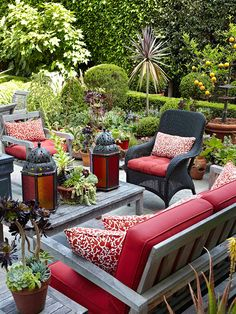 In landscapes that include lots of different plant types and textures, too much additional pattern can be overwhelming. Small doses are a good way to provide visual relief as well as interesting contrast to furniture. This patio set's solid-red seating cushions are paired with red-and-white pattern accent pillows for a pop of style.