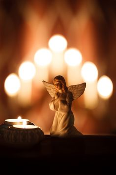 angel statue and candles