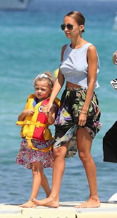 Nicole Richie in her vacation outfit: a crop top and floral maxi skirt