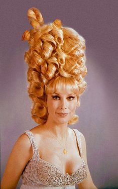 Barbara Eden from way back when her face was still real and her hair was fake.