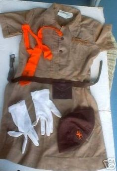 Brownie Uniform....I was so proud of this in the 60's.  Wore it to school on meeting day, minus the gloves...those were worn only for special occasions like Girl Scout Sunday church service and ceremonies. I still have mine.
