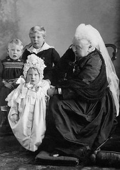 Queen Victoria with grandchildren Prince George, Princess Mary, and Prince Edward of York. (Queen Elizabeth II is a great great granddaughter of Queen Victoria.)