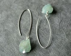 This minimalist pair of earrings features two rough, raw genuine aquamarine nuggets (unpolished), set on silver plated paddle pins and dangling from long, handmade elongated sterling silver ear wires. Estilo Hippie Chic, Hippy Chic, Aquamarine Earrings, Gemstone Earrings, Etsy Jewelry, Wire Jewelry, Jewlery, Women's Earrings, Silver Earrings