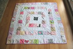 I love this idea.  I wanna make a quilt from Little Miss' clothes.  Surely, I can learn to sew straight lines, right?