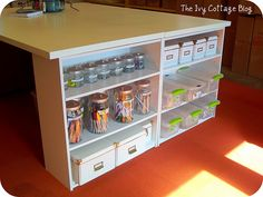 great idea for a DIY work table - two hollow core doors and 4 Walmart book cases. one day when i have room!