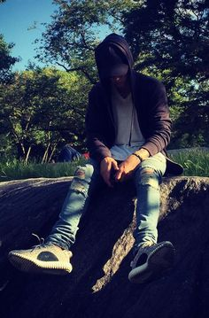 Justin Bieber Hanging out in the park wearing Saint Laurent ripped jeans and Adidas Yeezy boost