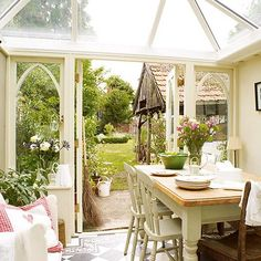 the sunroom of a sweet little english country cottage