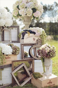 Vintage outdoor wedding decor:  hydrangeas, wooden crates, vintage mirrors and picture frames and fresh grapes.  For ideas and goods shop at Estate ReSale & ReDesign, LLC in Bonita Springs, FL