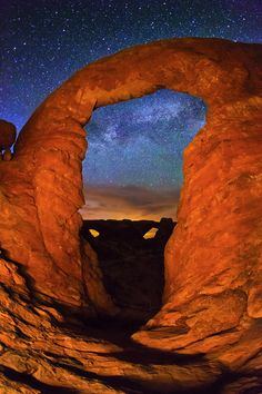 The Milky Way and North and South Window Arch National Park.