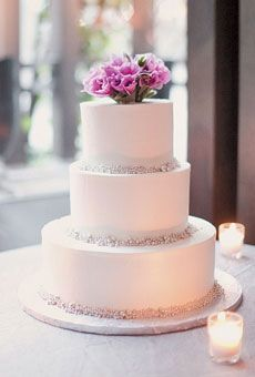 Buttercream-frosted wedding cake from A Simple Cake, topped with fresh flowers. Photo by Elisabeth Millay with Kelly Kollar. #weddings #weddingcakes