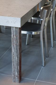 This central concrete table seats up to 14 people and features contrasting table legs that are made from wood sourced from un-used barns in Canada. The concrete table, measuring an impressive 300cm x 110cm, was made from a specially created lightweight Béton Lège Concrete surface that was developed by Concrete by LCDA - See more at: http://www.interiorbulletin.co.uk/concrete-by-lcda-projects-available-from-uk-agents-holloways-of-ludlow/#sthash.gBstRvBS.dpuf
