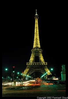 The Eiffel Tower at night looks like it's made of golden lace.