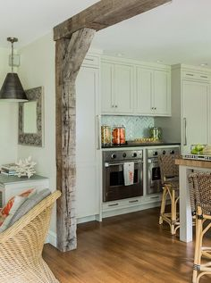 Kitchen, two stoves, ovens, grey cabinetry, butcher block, reclaimed wood,