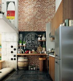 """Notice the """"wine cellar"""" on the left wall.  The barrel and stool can be used for sitting while eating as well as sitting while preparing a meal.  Large art on the wall works nicely in small spaces.  It makes the wall appear bigger."""
