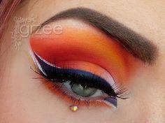 Beautiful orange and navy eye for evening. #uttyler