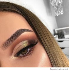 Gold eye makeup and a nice hair color