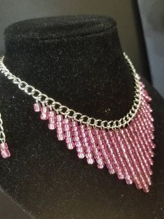 Check out this item in my Etsy shop https://www.etsy.com/listing/537265390/pink-silver-bib-style-seedbead-fringe