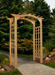 The Westwood Arbor by New England Arbors       Made of pre-stained cedar, The Westwood Arbor is easy to assemble and install. This arbor has a graceful, swooping top and detailed side panels for a fantastic finish. This piece ships as an unassembled kit in one box. Please allow at least one hour for assembly.         Premium weather-resistant cedar   Cedar is rot-, mildew- and insect-resistant   Interior width: 42 inches; Posts: 2L x 3.5W inches   Outside Dimensions: 47W X 24D X ...