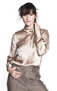 Beige Satiny Shirt by Seventy This silk satiny shirt is designed by the Italian brand Seventy. Belted with two chest pocketsa and in the shade of beige/gold. 100% Silk