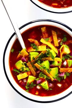 LOVE this Quinoa Tortilla Soup! It's naturally vegetarian, vegan and gluten-free. It's full of big flavors, made with the most delicious chile tomato broth, and best when piled high with lots of avocado and toppings. And it is totally hearty, comforting and delicious. Easy Mexican dinner for the win!   Gimme Some Oven #tortillasoup #mexican #glutenfree #vegan #vegetarian #soup
