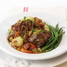 """""""During winter I always get requests for oxtail stew recipes. The gremolata gives the dish a real flavour boost,"""" says Ina Paarman. Oxtail Recipes, Beef Recipes, Real Food Recipes, Cooker Recipes, Yummy Recipes, South African Recipes, Ethnic Recipes, Oxtail Stew, Work Meals"""