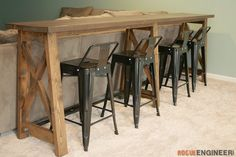 Are you looking for a way to add more seating to your space? This DIY Bar Top Console Table from Jamison over at Rogue Engineer is a great solution to that problem. Bar Table, Pub Table Sets, Table Behind Couch, Bar Table Behind Couch, Furniture, Bar Furniture, Bar Height Table, Bar Table Diy, Basement Decor