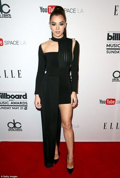 Classy: Hailee Steinfeld, 20, was the epitome of sophistication in an oblong black gown that shows off her toned legs.