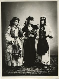 Women's clothing, © The Historical Archive of Sarajevo 1907 1) light-coloured urban dress with traditional elements: embroidered vest (jelek) and a metal belt buckle (Badem pafte), headdress; 2) urban dress with traditional elements: dark pantaloons (dimije) with a metal belt buckle (Badem pafte), a wide-sleeved embroidered jacket (jelek) and a headdress; 3) a Christian folk costume richly adorned with coins, apron (pregača), headdress.