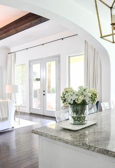 Living room large window wall white custom white drapery panels
