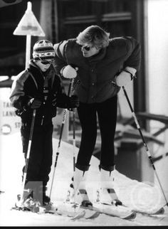 Princess Diana, possibly instructing one of her sons on the art of skiing.........
