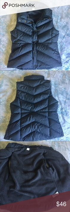 """J. Crew down and feather gray puffer vest Cute and warm vest in dark gray. Fuzzy materiel inside.  Down and feather fill to keep you warm.  Zipper and snap closure.  Zip all the way up for warmth.  Pull string synch on the inside.   pockets snap close. Flattering cut to create a slimming effect. Size medium. Approximate measurements 19"""" armpit to armpit, 36"""" waist, 8"""" arm opening. 23"""" length. EUC J. Crew Jackets & Coats Vests"""