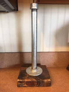 Industrial iron or galvanized pipe paper towel holder with sturdy wood base. Measures 6x6 at the base and is 14 tall comes in a variety of pipe sizes and wood stains. If you dont see what your looking for just ask and we can work on a custom item just for you. ** As this item is hand made, please allow 1-2 weeks for your item to be made**