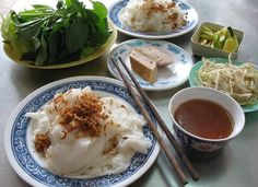 """""""Bánh Cuốn """"/    Rice flour rolls stuffed with ground pork, prawns, and wood ear mushroom. They are eaten in a variety of ways with many side dishes, including one out of many kinds of chả (sausage)."""