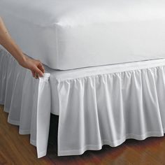 Detachable gathered cotton bedskirt with split corners. Attaches with Velcro®. This bedskirt is gathered at the top for an extra-luxurious look.