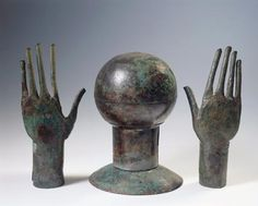 Etruscan civilization, 7th century b. C. Stylized bronze hands and head. From Vulci (Latium region, Italy). Rome, Museo Nazionale Etrusco Di Villa Giulia