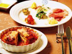 《 洗足池 》前菜は、北イタリアの生ハム、さつまいものムース、かきのコンフィなど10種。何層にも重なったモチモチの手打ちラザニアは、濃厚な見た目と裏腹に爽やかな味わい。  手うち、焼きたて、無添加の愛情たっぷりイタリアン『Trattoria Magari』  宝石のごとき10種の前菜と、メインorパスタが楽しめる充実のコース。『マガーリ』の料理は全工程で化学調味料を使用しないため、旨みが強いのに爽やかな味わいで素材を存分に楽しめる。   もとは赤坂で人気店をきりもりしていたソムリエの綿谷さんと高須シェフが落ちついた店にしたいと移転。今では地元のマダムに愛される名店に。手打ちパスタは常時6種、パンは毎朝焼きたてを用意。愛情満載の味にリピート確定だ。