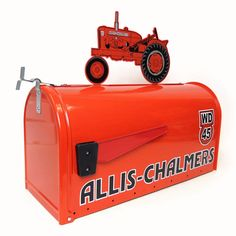 Allis Chalmers Rural Style Mailbox...around here we like all this kind of stuff...at least one..