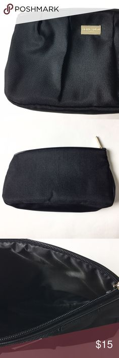 Giorgio Armani Perfume Makeup Bag Details: Armani perfume accessory bag in excellent condition with plastic still on front logo.   Kate Harrington Boutique does not trade or negotiate price in the comment section. However, for most items we may consider reasonable offers.   Happy Poshing! Giorgio Armani Bags Cosmetic Bags & Cases